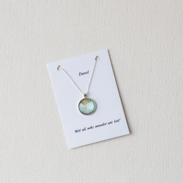 Globe world map necklace souled in love globe world map necklace gumiabroncs Image collections